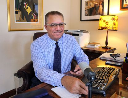 DeWayne Wickham, founding dean of the journalism school at Morgan State University and co-founder of the National Association of Black Journalists, working in his office at his Orlando home, Wednesday, January 27, 2021. (Joe Burbank/Orlando Sentinel)
