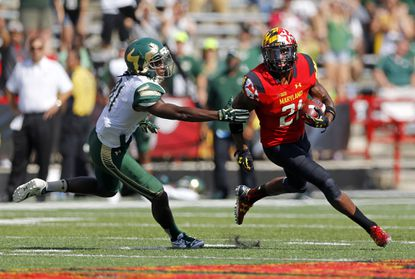 Maryland defensive back Sean Davis, right, rushes past South Florida wide receiver Ryeshene Bronson after intercepting a pass in the second half.
