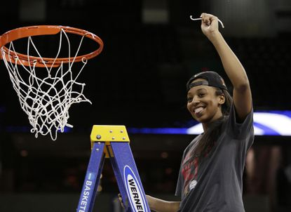 Maryland's Lexie Brown holds piece of a net after winning a women's college basketball regional final game against Tennessee in the NCAA tournament, Monday, March 30, 2015, in Spokane, Wash. Maryland won 58-48.