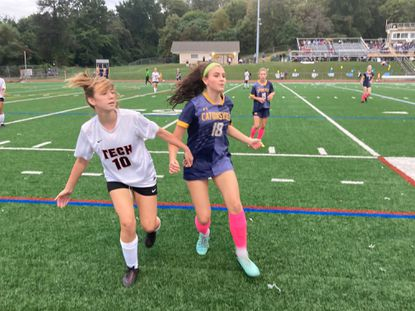 Catonsville's Stella Carmelo, right, and Eastern Tech's Brooke Taylor jockey for position on a throw-in in the Mavericks' 3-0 victory.