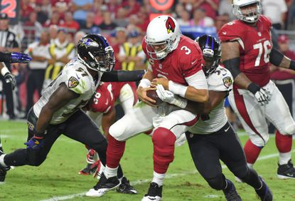 Ravens linebacker Zachary Orr (54) sacks Cardinals quarterback Carson Palmer in the fourth quarter on Oct. 26, 2015, at University of Phoenix Stadium.