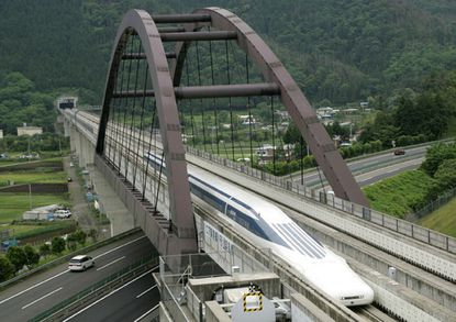 Central Japan Railway Co.'s Maglev train, which is levitated and propelled forward by magnetic force, speeds at a test track in Tsuru, west of Tokyo. (Reuters staff photo).