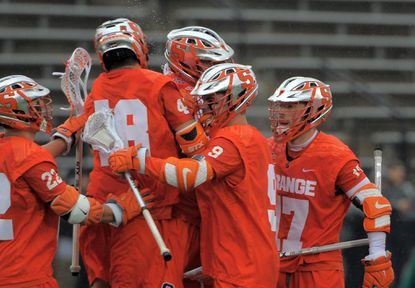 Syracuse players celebrate after their fourth goal against the Hopkins Bue Jays in men's lacrosse at Hopkins in March.