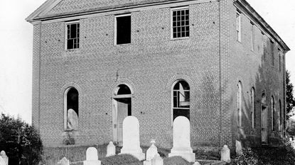 Pictured on the eve of its demolition is the Union Meeting House that stood at the center of the Westminster Cemetery, from 1808-1891.