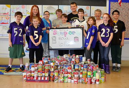 Shown from left are St. John Student Council members Cole Smith, Kristen Miller, Lucy Yezulinas, Victoria Kapfer, Garrett Keidel, Greg Keidel, Colin Rzepkowski, Sam Hoerl, Sydney O'Connor, Pat Rafferty of the St. Vincent de Paul Society, Sophie Stromberg and Matthew Hawkins.
