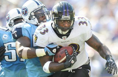 Ravens fullback Le'Ron McClain tries to escape a tackle from the Titans' Stephen Tulloch during a 2008 game.