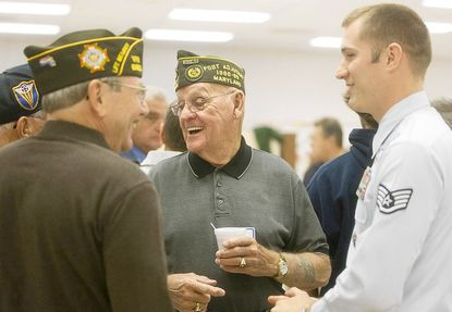 From left, Jim Harris and Ray Wilson, both of Union Bridge, talk to Kevin Warmington of Frederick about how the Air Force uniform has changed over the years. Harris and Wilson are both Air Force veterans while Warmington is an Air Force recruiter. They were at Francis Scott Key High School on Nov. 9 to attend a veterans recognition breakfast.