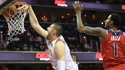 Atlanta Hawks center Alex Len (25) dunks past Washington Wizards forward Trevor Ariza (1) during the first half Wednesday, Jan. 2 in Washington. Len signed a signed a two-year, $8.5 million deal with Atlanta after five years with the Phoenix Suns.