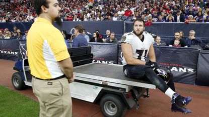 Ravens right tackle Rick Wagner leaves the game against the Houston Texans on the back of a cart with a foot injury.