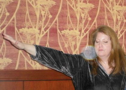 """Laine Crosby is shown """"speaking with spirits"""" at the Marriott in Gettysburg. She will tell stories of New Windsor's ghosts at the Heritage Committee's ghost talk, Saturday."""