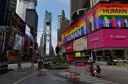 Digital billboards like those lining New York City's Times Square could soon be coming to Baltimore's Pratt Street corridor under a Downtown Partnership of Baltimore plan. File. (Angela Weiss/AFP via Getty Images).