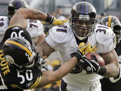 Pittsburgh Steelers linebacker Larry Foote can't bring down Ravens running back Jamal Lewis on a three-yard run to the Pittsburgh 12-yard line, during the second quarter of a football game, in Pittsburgh, Sunday, Dec. 24, 2006.