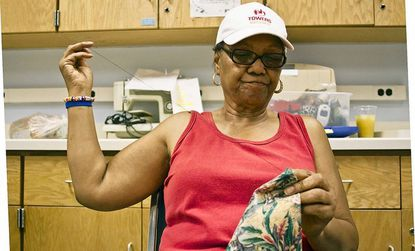 Arnetta Ross, a member of the quilting and craft group at the Lansdowne-Baltimore Highlands Senior Center, works on her African-themed quilt July 27.