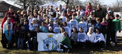 Members of Owen United particpated in the 2012 Polar Bear Plunge. Owen Reynolds, center, helps hold the banner.