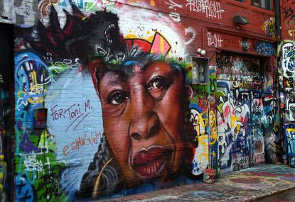 Artist Ernest Shaw Jr. painted this mural in honor of author Toni Morrison. It is located in Graffiti Alley in the Station North neighborhood.
