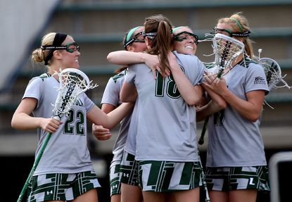 Loyola players celebrate after scoring a goal.