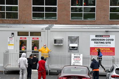 People patiently wait outside the Aberdeen COVID testing site Wednesday morning. Appointments are required to be tested at the facility which is located on the grounds of the new Upper Chesapeake Medical Center Aberdeen Campus on Rt. 22.
