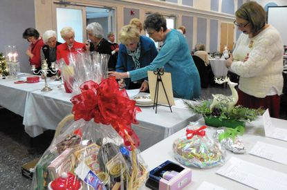 Clubwomen and guests shop at the luncheon's silent auction.