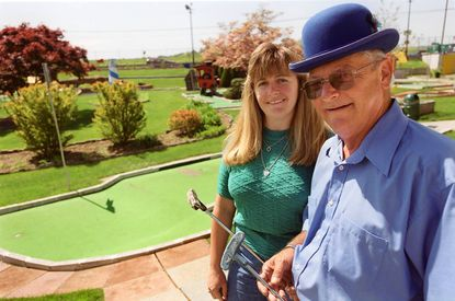 Gus Novotny, with his daughter, Carol Wolfe, at Rocky Gorge Golf Practice Range in 2002.