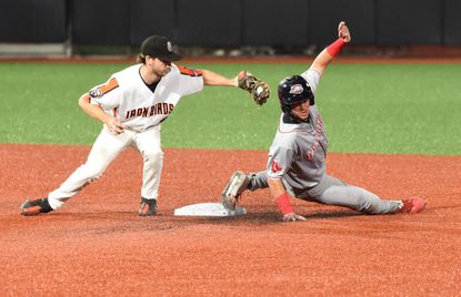 Aberdeen's Adam Hall, left, comes up late in a tag attempt as Greenville's Tyler Dearden successfully advances to second base on a wild pitch in the 3rd inning during an IronBirds home game at Ripken Stadium on Wednesday, Sept. 15, 2021.