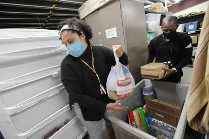 Aysia Jefferson and Barry Solomon put away a delivery of food for the family shelter at Human Services Programs of Carroll County in Westminster Tuesday, Nov. 24, 2020.