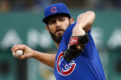 Cubs starting pitcher Jake Arrieta warms up in the first inning against the Pittsburgh Pirates on Aug. 4.