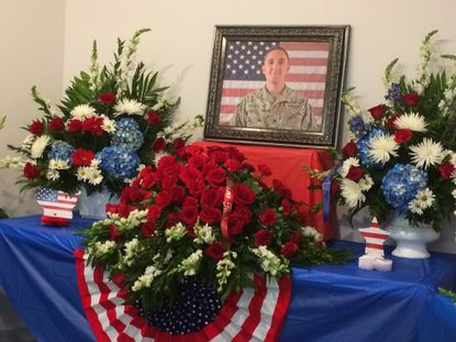Family and friends gathered Sunday at a memorial service for Sgt. Eric Houck, who was killed in Afghanistan.