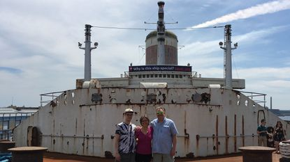 Laura Zeichner Embrey, center, with her son Robert, left, and brother Gary Zeichner aboard the SS United States.