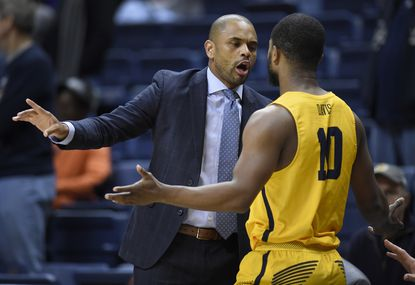 Coppin State head coach Juan Dixon, left, talks with Coppin State's Karonn Davis during the first half of an NCAA college basketball game, Saturday, Dec. 9, 2017, in Storrs, Conn. (AP Photo/Jessica Hill)