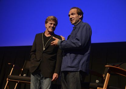 Robert Redford accepts his Silver Medallion from actor Ralph Fiennes at the 2013 Telluride Film Festival in Telluride, Colo.