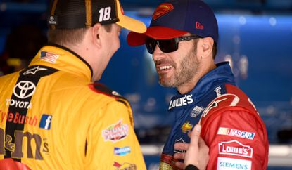 NASCAR drivers Jimmie Johnson, right, and Kyle Busch, chat in the garage area during practice Friday for the Sprint Cup Series Auto Club 400.
