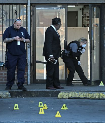 Police investigate a fatal shooting at Pizza Man, a carryout on the corner of Reisterstown Road and Cold Spring Lane. April 2, 2020.