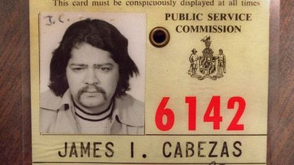 James Cabezas kept his city taxi license from the early 1970's in his Towson office.