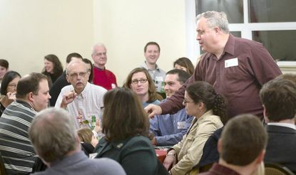 Gene Ruhl, standing at right, hosts a reunion for Eagle Scouts from Boy Scout Troop 485 at Immanuel Episcopal Church in Glencoe on Dec. 23. Since, Ruhl, of Monkton, became scoutmaster of Troop 485 in 1986, some 69 boys have become Eagle Scouts, the highest rank a Scout can achieve. This year's reunion brought 40 Scouts and their families.