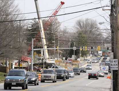 While construction work on the Frederick Road bridge spanning the Baltimore Beltway has added to the congestion on Catonsville's main street, as seen here March 8, residents on both sides of the bridge have adjusted to life as the three-year, $20-million project continues.