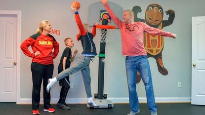 University of Maryland women's basketball coach Brenda Frese, her husband, Mark Thomas, and their two kids, Markus (L) and Tyler, are longtime residents of Laurel. They relax at home on a recent evening before heading out on a Terps road trip.