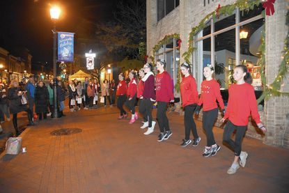 Performers from the Dance Center of Severna Park dance on Main Street. Shoppers come out to Main Street and the surrounding Annapolis area for Midnight Madness.