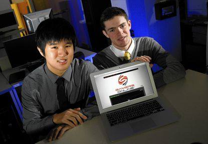 Howard Community College students John Kim (L) and Hunter Tessier emerge as winners in the Entrepreneurial Celebration after ten handpicked students gave three to five minute presentations about a business they hope to launch. Tessier's home page is shown.