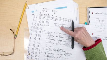 Jo Curtin takes detailed notes to keep up with the lesson during the 15-week Korean for Beginners course at the Miller Branch Library in Ellicott City. Students learn key aspects of the Korean alphabet, culture, food and basic expressions.