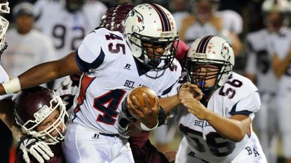 Bel Air's Devin Bowers battles for a few yards as Havre de Grace defender Jack Smith tries to take him down.