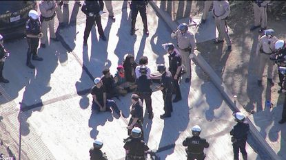 Demonstrators block the northbound lanes of the 101 Freeway near Alvarado Street in Los Angeles on Nov. 26, 2014.