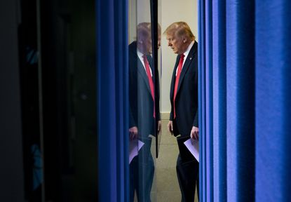 President Donald Trump enters the White House briefing room in Washington, on Thursday, July 2, 2020. Mary Trump, the president's niece, was a family outcast. Her new book casts a cold light on the relatives she describes as dysfunctional.
