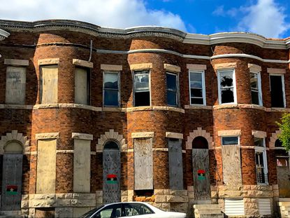 The boarded-up rowhouses with curved fronts along the 1800 block of N. Fulton Avenue in West Baltimore are among thousands of vacants across the city.