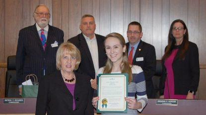 John Carroll School senior Caitlyn Trent, right front, is honored by the Bel Air town commissioners Monday with a Student Achievement Award.