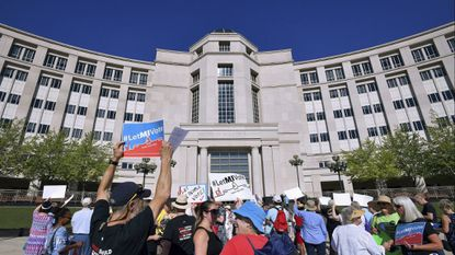 Demonstrators rally in Lansing, Mich. on July 18, as the state's Supreme Court heard arguments about whether voters should be able to pass a constitutional amendment that would change how the state's voting maps are drawn.