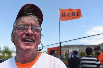 """Til Strudwick, 65, of North Baltimore, was at Memorial Stadium on May 8, 1966 to witness the home run Frank Robinson hit out of the ball park in a game against the Cleveland Indians. A ceremony was held at the site of Memorial Stadium to commemorate the 50th anniversary of Robinson's home run - the only time an Oriole has hit a home run out of the ball park. Community activist Mark Melonas organized the celebration, and hoisted a new """"HERE"""" flag at the YMCA Ripken field to recall the original """"HERE"""" flag that flew at the stadium near the spot where the ball sailed over the bleachers in left field into the parking lot."""