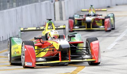 Daniel Abt, foreground, and Lucas di Grassi, rear, in the Audi Sport ABT team cars race during the Formula E Miami ePrix auto race in Miami on March 14.