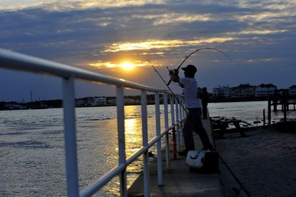 Casting a surf rod at Inlet Park in Ocean City as the sun sets is one way to cap off your day at the beach.