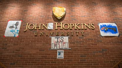 Signs cover the walls inside of Johns Hopkins University's Garland Hall during the sit-in. A group of students sat in the university's administration building as part of their protest against private police.