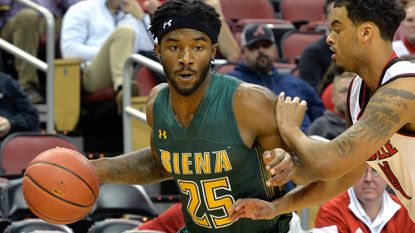 Siena guard Nico Clareth attempts to drive by Louisville guard Quentin Snider during the first half of their Dec. 6 game.